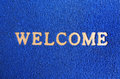 Blue carpet welcome mat. Stock Images