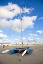 Blue catamaran boat on beach with sky Stock Photography