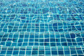 Blue ceramic wall tiles and details of surface on swimming pool Royalty Free Stock Photo