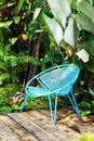 Blue chair in garden Royalty Free Stock Photography