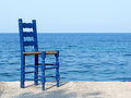 Blue chair at the sea in Greece Royalty Free Stock Photo