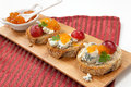 Blue cheese and apricot jam crostini multigrain with grapes parsley on wooden tray apricote mini bowl Stock Photo