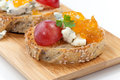 Blue cheese and apricot jam crostini multigrain with grapes parsley on wooden tray apricote mini bowl Stock Photos