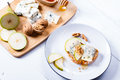 Blue cheese with slices of pear nuts and honey sandwich on bamboo wooden cutting board plate Stock Image