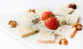 Blue cheese with strawberries and walnuts on a white background Royalty Free Stock Photography