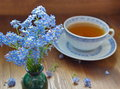 Blue china tea cup with forget me nots Royalty Free Stock Photo