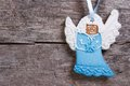 Blue christmas angel on a background of wooden ginger biscuits Stock Images
