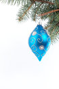 Blue Christmas ball hanging on spruce branch Royalty Free Stock Images
