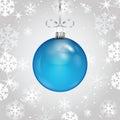 Blue Christmas ball on a silver ribbon Royalty Free Stock Photo