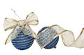 Blue christmas balls and glitter ribbon isolated on white Royalty Free Stock Photos
