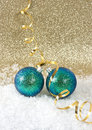 Blue christmas baubles with golden streamer Royalty Free Stock Photo