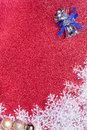 Blue christmas bells and snowflake on red background decoration Royalty Free Stock Images