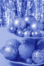 Blue christmas card with balls stock photos xmas picture of centerpiece ornaments on blurred lights background Stock Image