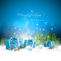 Blue christmas greeting card with gift boxes and branches in snow Stock Image