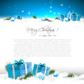 Blue christmas greeting card with gift boxes and branches in snow and with place for text Stock Photos