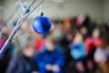 Blue christmas ornament hanging on a tree branch Royalty Free Stock Photos
