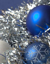 Blue christmas ornaments - silvery background Royalty Free Stock Image