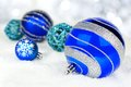Blue Christmas ornaments in snow Royalty Free Stock Photo