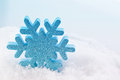 Blue christmas snowflake star decoration in snow Royalty Free Stock Image