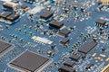 Blue circuit board pcb close up chips transistors resisto detailed macro shot of a Royalty Free Stock Photography