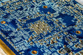Blue circuit board PCB with many microscopic electronic parts Royalty Free Stock Photo