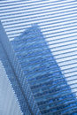 Blue clean glass wall of modern skyscraper day shot Royalty Free Stock Image
