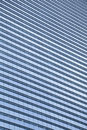 Blue clean glass wall of modern skyscraper day shot Royalty Free Stock Images