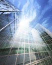 Blue clean glass wall of modern skyscraper perspective view Royalty Free Stock Photography