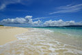 Blue clear sea with waves and sky with clouds summer beautiful beach of okinawa Stock Photos