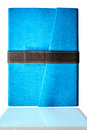 Blue closed book isolated over white background Royalty Free Stock Photo