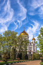 Blue cloudy sky above a golden orthodox church in summer Royalty Free Stock Photo
