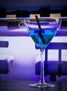 Blue cocktail drink on a lounge bar table with space for text Royalty Free Stock Photo