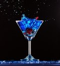 Blue cocktail splashing Royalty Free Stock Image