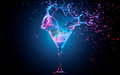 Blue cocktail with splashing water Royalty Free Stock Photo