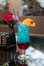 Blue cocktail on table layered based liquor curacao Stock Photos