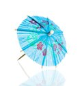 Blue cocktail umbrella isolated against white background Royalty Free Stock Photo