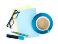 Blue coffee cup glasses and office supplies view from above isolated on white background Stock Photos