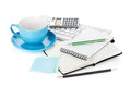 Blue coffee cup and office supplies Royalty Free Stock Image