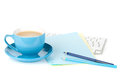 Blue coffee cup and office supplies Stock Image