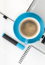 Blue coffee cup and office supplies view from above on white background Royalty Free Stock Photos