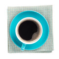 Blue coffee cup over kitchen towel view from above isolated on white background Stock Image