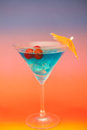 Blue cold cocktail with berries on a colorful background Stock Image