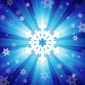 Blue color burst of light with snowflakes Royalty Free Stock Photo