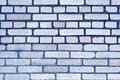 Blue color grungy brick wall pattern.