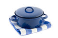 Blue cooking pan on a blue checkered tea towel isolated white Stock Image