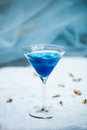 Blue cool refreshing summer cocktail drink with ice  in glass Royalty Free Stock Photo