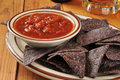 Blue corn chhips and salsa a plate of tortilla chips with beer Royalty Free Stock Photography