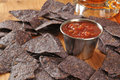 Blue corn tortilla chips with salsa and beer Royalty Free Stock Photography
