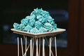 Blue crispy sweets on the white plate Royalty Free Stock Photo