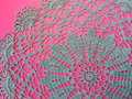 Blue crochet serviette on pink background Royalty Free Stock Photos